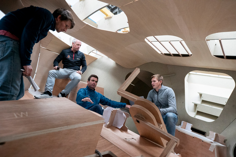11th hour racing team tour the boat mock-up for the cockpit of their new IMOCA 60 being built for The Ocean Race 2022-23