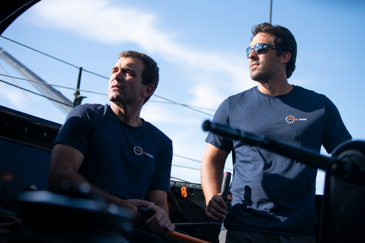 Charlie enright and mark towill sailing on foiling imoca 60 11th hour racing team